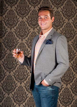 Garrison Fuller, an administrative assistant at Taryn Hebert RE/MAX Beaumont, wears an extra slim Bengali stripe dress shirt, Photographer Blazer, Rocco SLim Fit Jean and a brown leather belt from Express in Parkdale Mall.<br /> Photo/ Scott Eslinger-Eslinger Photographics ©2013