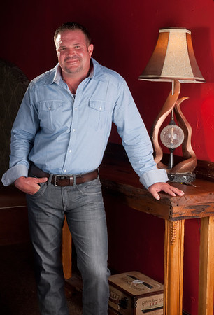 Derek Theeck, general manager at Mike Smith Honda and Mercedes, wears Slim fit shirt buckle black, BKE Charcoal Jake jeans and a Fossil brown leather belt from Buckle in Parkdale Mall.<br /> Photo/ Scott Eslinger-Eslinger Photographics ©2013