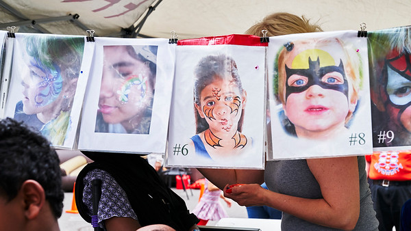 Faces on faces.  Lyndale Neighborhood Association annual picnic.  Minneapolis, Minnesota - June 22.