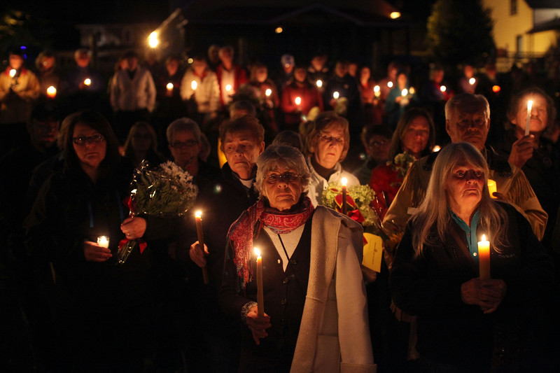Hundreds of people gather for a candlelight vigil for the three slain murdered women  in Wilno, Ontario.