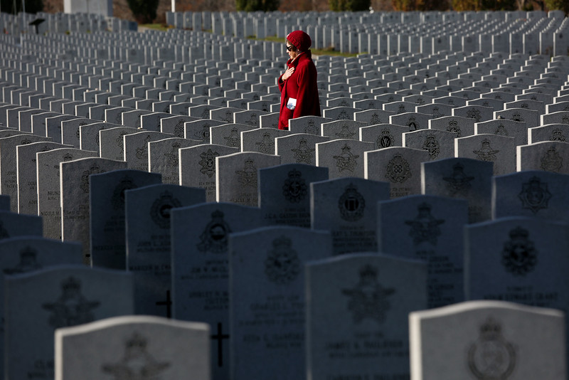 A woman pays her respects at The National Military Cemetery of the Canadian Forces in Ottawa.