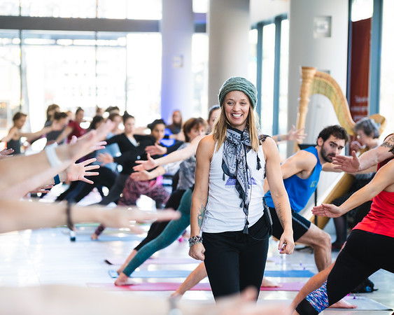 Michelle Henkel leads the class at the Minnesota Orchestra's new yoga series, while orchestra musician Kathy Kienzle accompanies the session on harp.  Minneapolis, Minnesota - February 18.