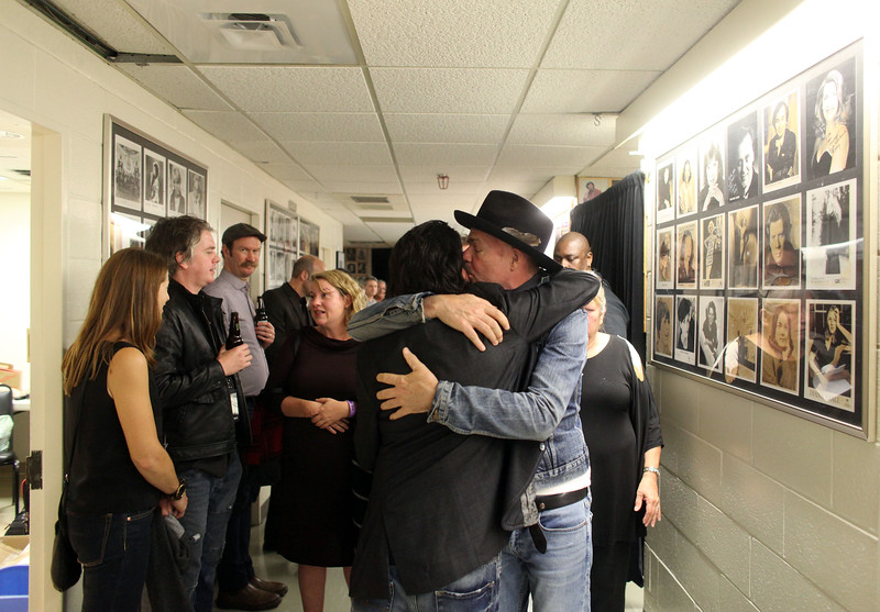 Gord Downie hugs former band member Paul Langlois after the performance of Secret Path at NAC in Ottawa.