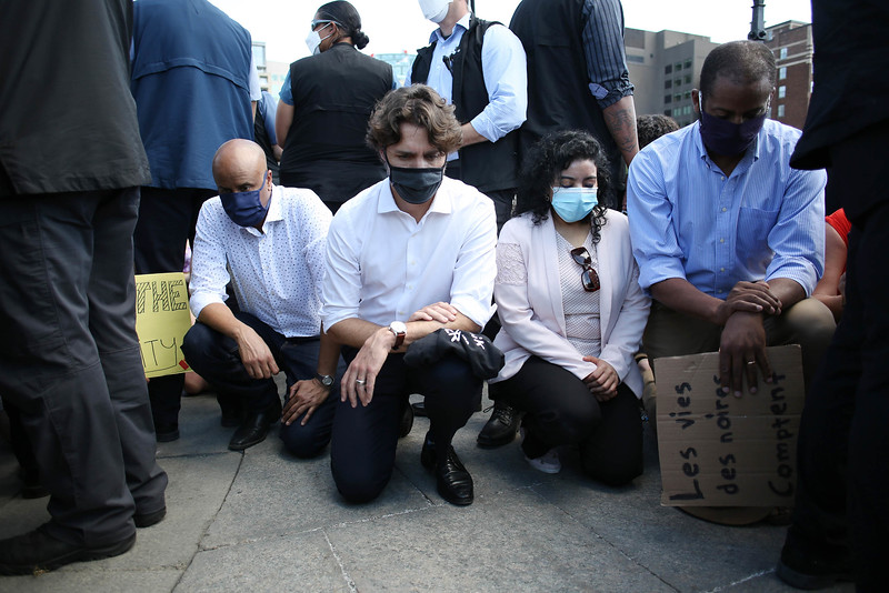 Canada's Prime Minister Justin Trudeau (2nd Left) kneel during a Black Lives Matter protest on Parliament Hill in Ottawa, Canada.