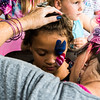 Hazyl  Campbell holds perfectly still for some facepainting Saturday at the Downown Palatine Street Fest.