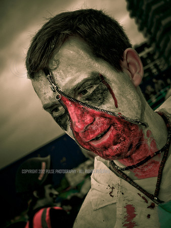A zipper-faced Zombie at the gathering point near the West Pier in Brighton.