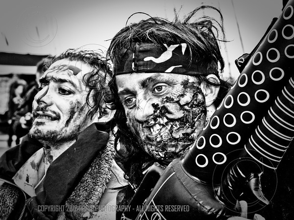 An aggressive Rambo look-alike Zombie at the gathering point near the West Pier in Brighton.