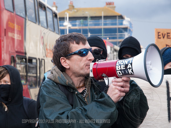 A demonstration leader using a megaphone to alert the public along Westerm Road in Brighton of there demands.