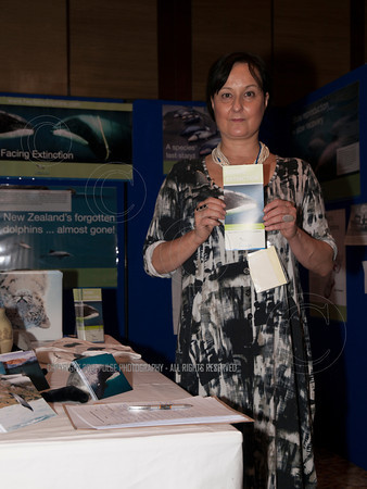 An exhibitor distributing leaflets about the imminent extinction of Hector and Maui whales.