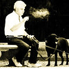 "A man with his dogs sitting down and taking a break at the part to have a smoke - Buenos Aires, Argentina.  Travel photo from Buenos Aires, Argentina. <a href=""http://nomadicsamuel.com"">http://nomadicsamuel.com</a>"
