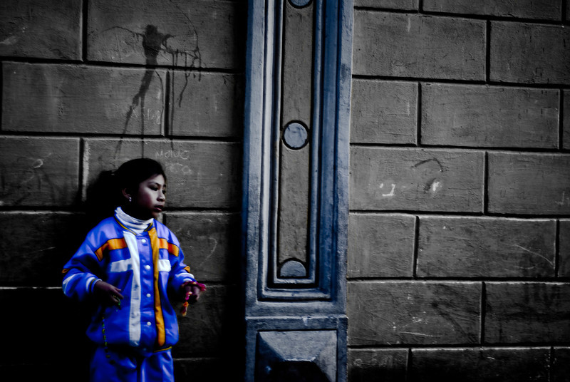 "<a href=""http://nomadicsamuel.com"">http://nomadicsamuel.com</a> : Today's daily travel photo is of a local Bolivian girl wearing a bright outfit leaning against a wall in Potosi, Bolivia."