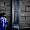 """<a href=""""http://nomadicsamuel.com"""">http://nomadicsamuel.com</a> : Today's daily travel photo is of a local Bolivian girl wearing a bright outfit leaning against a wall in Potosi, Bolivia."""