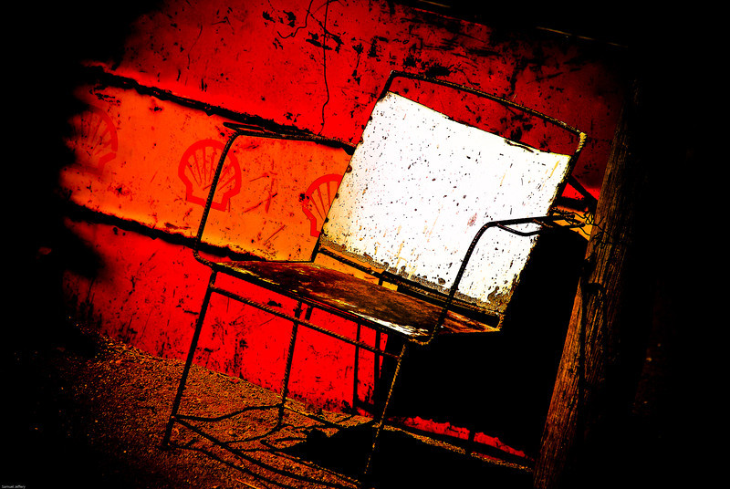 """An edited photo of a chair outside a gas station - San Pedro de Atacama, Chile.  Travel photo from San Pedro de Atacama, Chile. <a href=""""http://nomadicsamuel.com"""">http://nomadicsamuel.com</a>"""