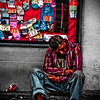 """A homeless man sitting on the curbside appears to be in agony - Quito, Ecuador.  Travel photo from Quito, Ecuador. <a href=""""http://nomadicsamuel.com"""">http://nomadicsamuel.com</a>"""