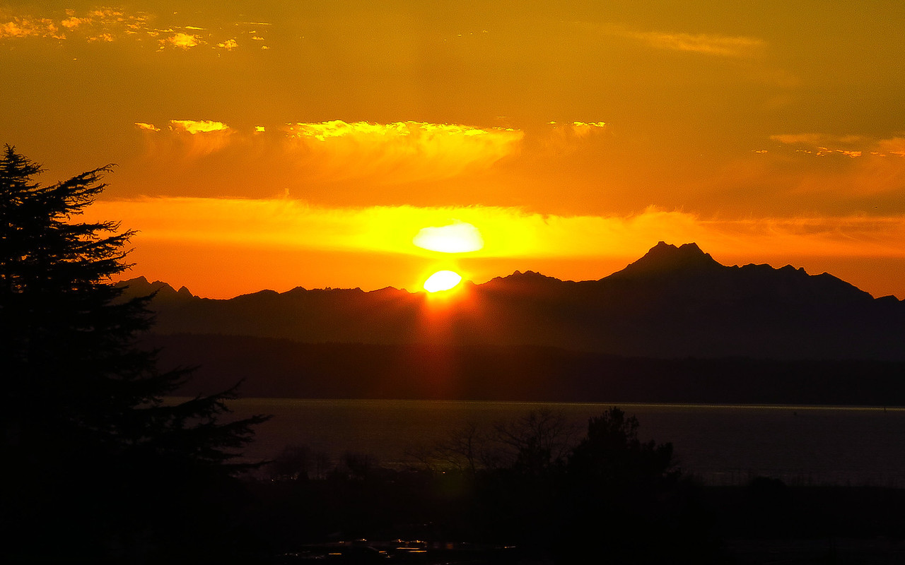 Sunset behind the Olympic Mountains in an image taken from the library on February 15.