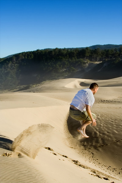 Me, jumping off a sand dune on the Oregon coast (2006)