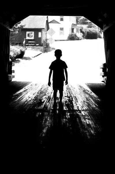 Silhouetted Kyle at the covered bridge (Ithaca, NY). Aug 2015, Tri-X and HP5 B&W film.
