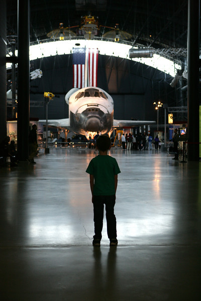 Kyle rounded the corner at the Udvar Hazy annex of the National Air and Space Museum and stopped dead in his tracks. He was awestruck by the Shuttle Discovery. Thirty-nine trips to space! Nov 2013