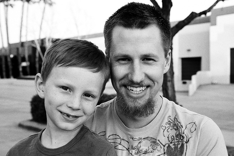 Uncle Mark and Kyle after the trampoline park. Taken with Ilford Delta 400. Mar 2013.