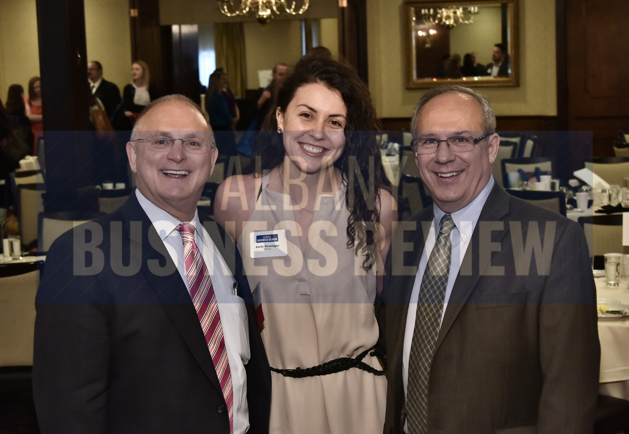 Emily Dessingue from Cresa with Andrew Matonak, president of Hudson Valley Community College, left, and Mark Mitchell from NYSERDA