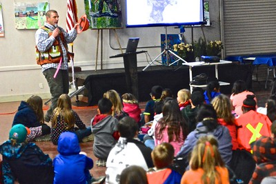 Kameron Crocker talks about forestry, logging and the teamwork  needed between foresters and loggers to be proper harvesters as Loleta  Elementary School students ask questions.  (Jose Quezada - For the Times-Standard)