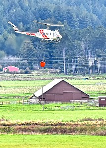 Cal Fire helitack chopper takes off from Ryan's Slough after filling  it's water bucket headed for a fire suppression demonstration at the   Redwood Acres for the 79th annual Redwood Region Logging Conference. (Jose Quezada - For the Times-Standard)