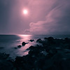 """<h2>Earth's Rhythm</h2> </br><p>The moon is heading toward setting with Venus leading the way to the horizon.  The view is from Maui looking East.  The island creeping in on the left is Lanai.  I woke at 4:30AM and went out on the balcony and saw what a beautiful night is was so I went for a short walk with my camera.  After capturing this image I was chased in by the rain.</p></br> <p>I setup the camera so that I could have a long exposure for the soft fluffy waves and a small aperture so the moon would have a star affect.  The wide angle lens was used to get a nice expanse of the shore and to minimize the star/planet streaks.</p></br> <p>In Lightroom I converted this to a duo-tone of red and blue. (You can see the original <a href=""""http://www.clightpictures.com/Travel/Hawaii-2011/i-sGzfLN7/2/X3/MG9986-X3.jpg"""">here</a>)</p>"""