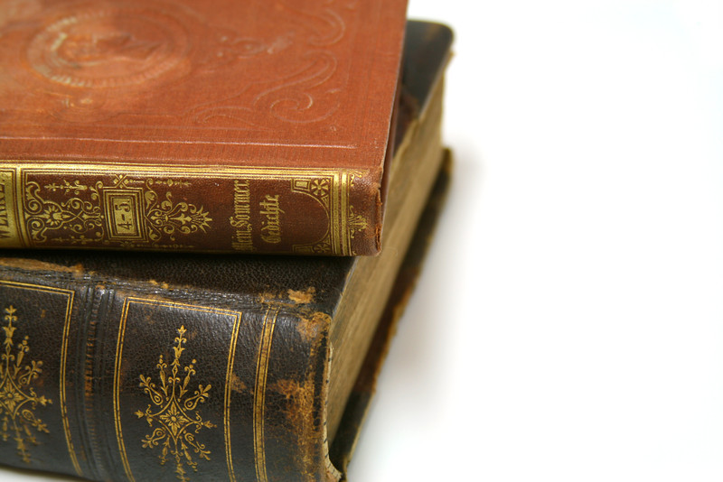 A stack of antique leather-bound books.