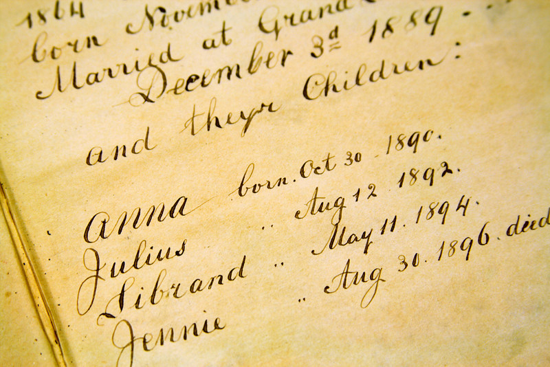 Genealogical birth record in the front of an antique Bible.
