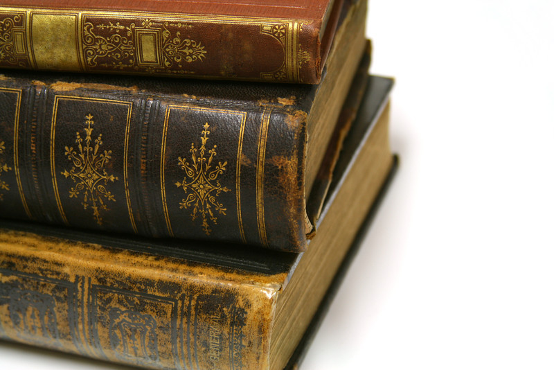 A stack of old, leather-bound books.