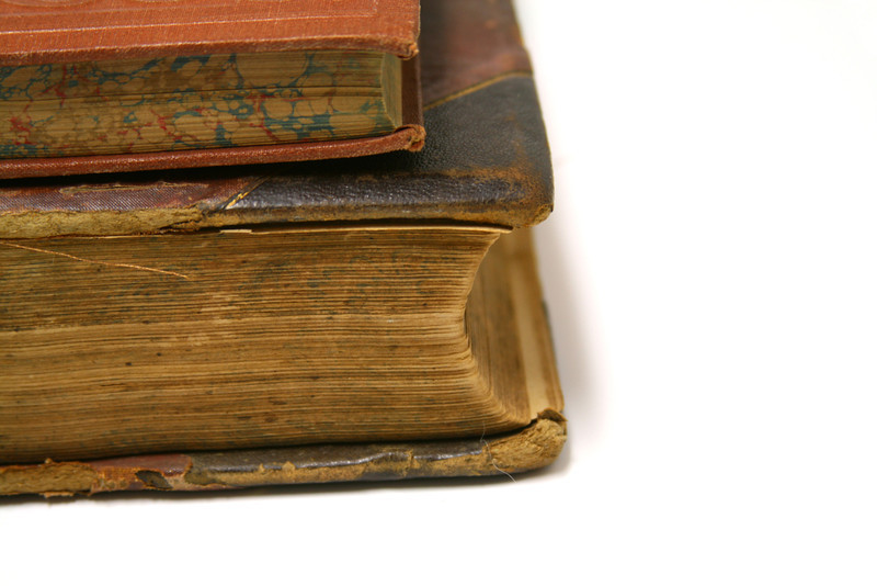 Antique leather-bound books.