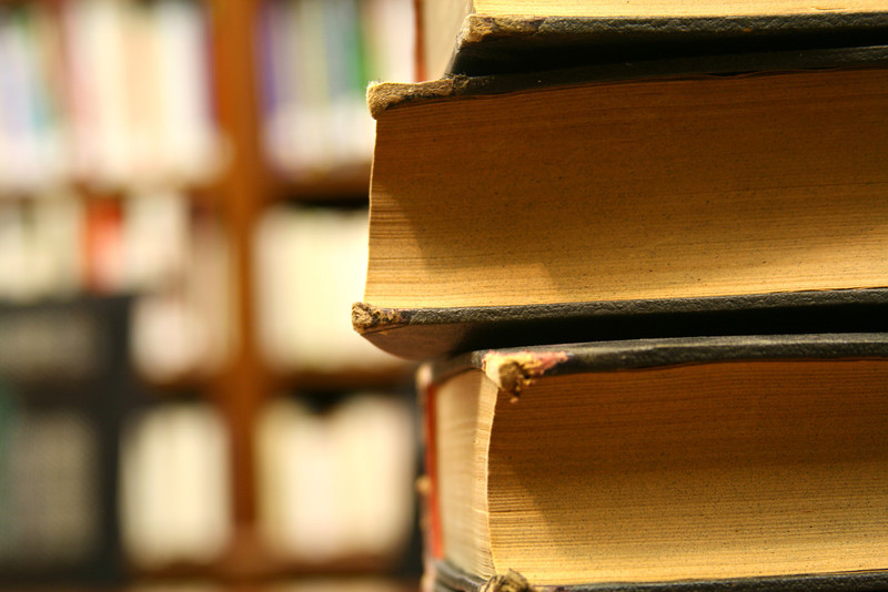 A library stack of well-worn books.