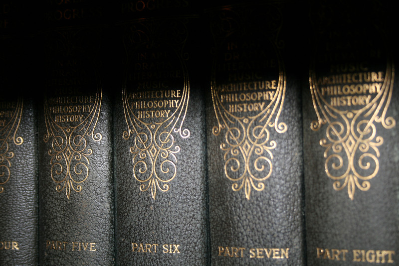 Deep shadows fall across antique books.