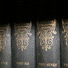 Deep shadows fall across antique books.