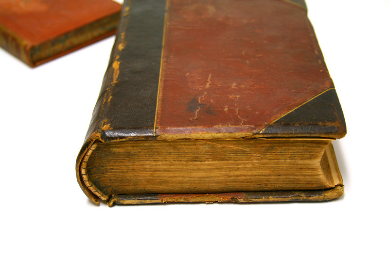 Old leather-bound book on white.