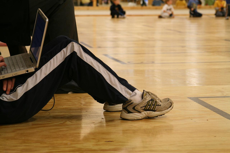 Student takes a break in the school gym.