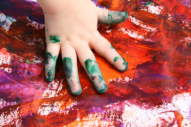 Primary arts and crafts: chubby bottles of poster paint are a real mess! Here's the aftermath: a five-fingered handprint.