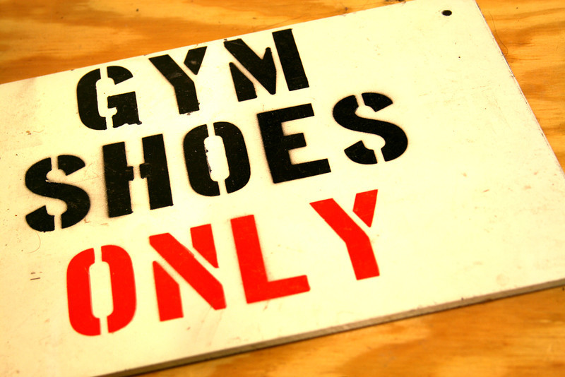 Gym shoes only warns the sign on the gym floor.