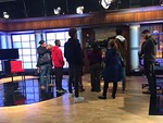 Students listen as Rosser explains more about the set in Studio A.