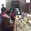 Sarah walks a couple of students through directing a show in the control room.