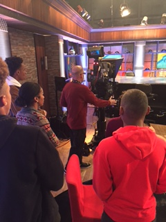 Students watch as Rosser explains how a studio camera works!