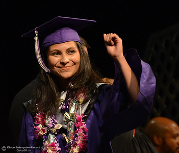 Raquel Zamudio-Hernandez gives a fist pump as she crosses the stage to receive her diploma during Inspire School of the Arts and Sciences graduation Wednesday, June 1, 2016, at Laxson Auditorium in Chico, California. (Dan Reidel -- Enterprise-Record)