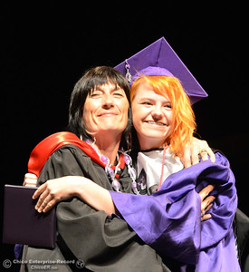 Senior advisor Danielle Alexich, left, gets a hug from graduate Siena Kelly during the Inspire School of the Arts and Sciences graduation Wednesday, June 1, 2016, at Laxson Auditorium in Chico, California. (Dan Reidel -- Enterprise-Record)