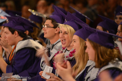Claire Ferrante, center, and other students get excited as the speechs and performances end and the graduates go onstage to get their diplomas during the Inspire School of the Arts and Sciences graduation Wednesday, June 1, 2016, at Laxson Auditorium in Chico, California. (Dan Reidel -- Enterprise-Record)
