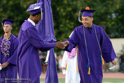 Varsity basketball teammates Stevontae Johnson, left, and Bobby Jones do a special handshake as they get ready to graduate during Oroville High School's Class of 2016 commencement Friday, June 10, 2016, at Harrison Stadium in Oroville, California. (Dan Reidel -- Mercury-Register)