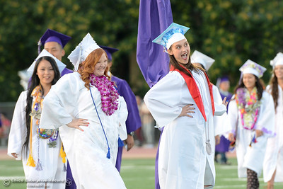 Raeanne Crosthwaite, left, and Dani Wilson, right, do a sassy pose as they enter the Oroville High School's Class of 2016 graduation Friday, June 10, 2016, at Harrison Stadium in Oroville, California. (Dan Reidel -- Mercury-Register)