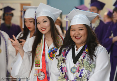 Julie Thao gives a peace sign as her fellow elcome speaker Audrey Thao, right, smiles as Oroville High School's Class of 2016 graduates Friday, June 10, 2016, at Harrison Stadium in Oroville, California. (Dan Reidel -- Mercury-Register)