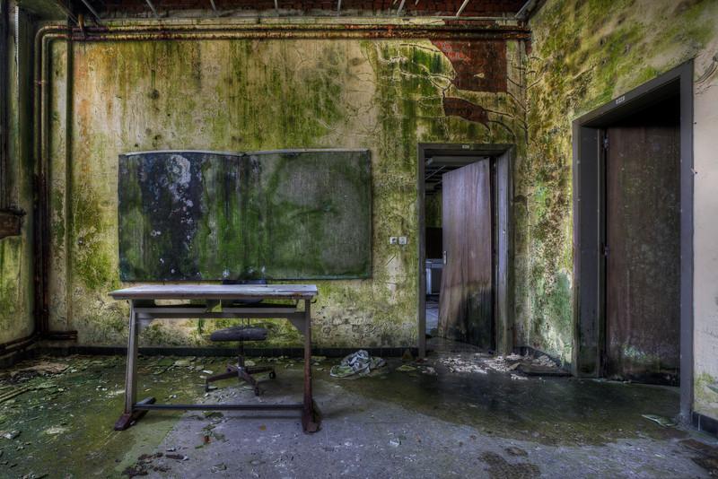 Abandoned school, an alien on the blackboard