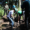 Young volunteers work under the guidance of the Washington Trails Association to build the Graham Preserve trail. SJPT Archives