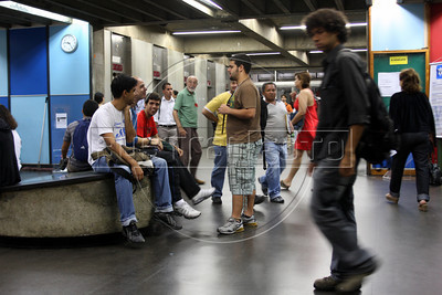 """Students and visitors enter the Rio de Janeiro State University (UERJ) main campus in Rio de Janeiro, Brazil. The UERJ was one of the first universities in Brazil to adopt admittance quotas based on race. The quota system sparked a huge debate in Brazil when first implemented, since some students which benefitted from the quotas, took the place of others who scored higher on entrance exams. The would-be student left behind claimed that the constitutional """"equal access to schooling"""" was not being obeyed. (Australfoto/Douglas Engle)"""